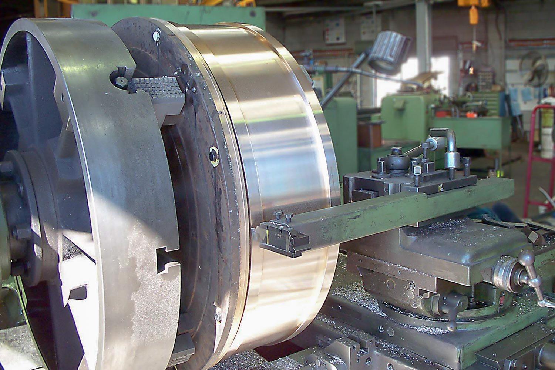 MACHINING OF BRONZE BUSH. APPROX 1M IN DIAMETER